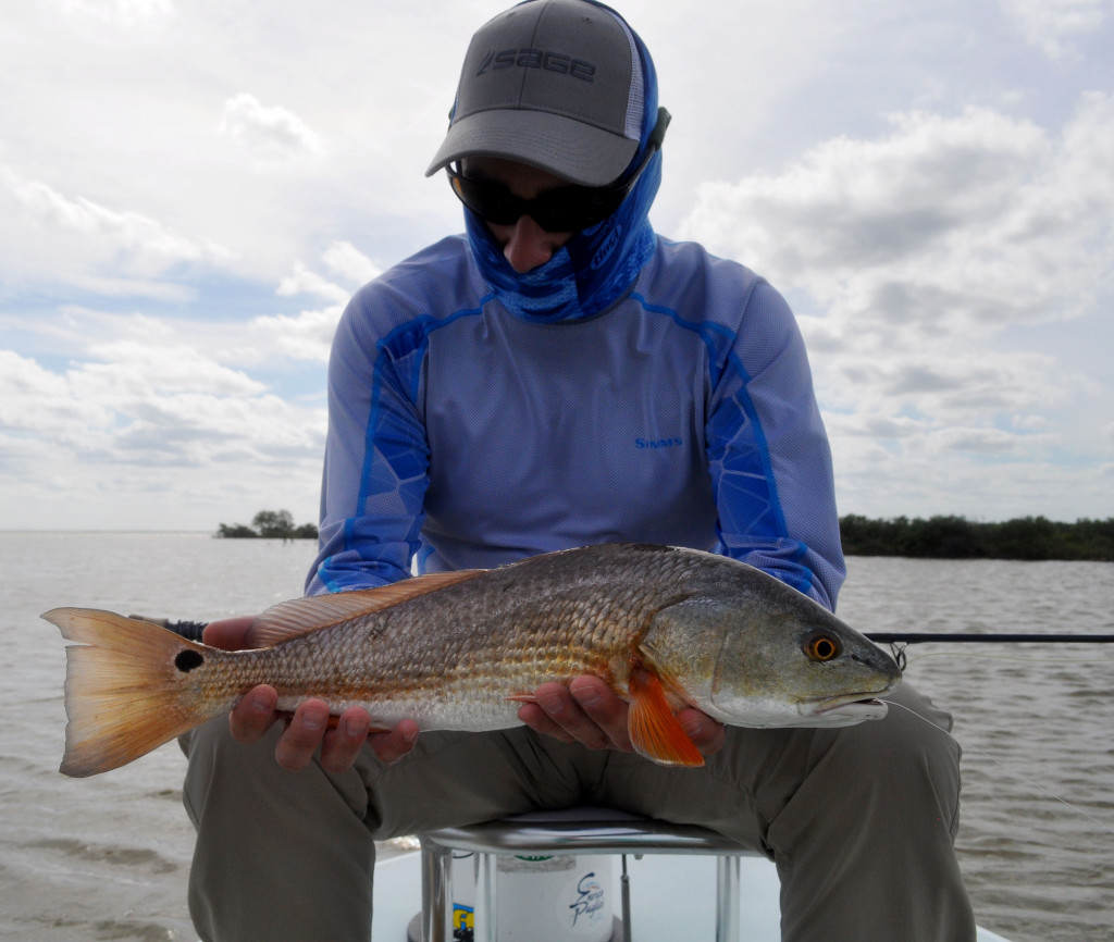 German Fly Angler, Chris, admiring his first Redfish. For those of you who have experienced this, you can understand that moment and feeling of putting your hands on that first caught species. Its an intense moment and I love getting to share it with clients over and over.