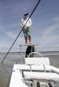 Fly Fishing Guide Capt. Jesse Register poling the shallows of Mosquito Lagoon for redfish.